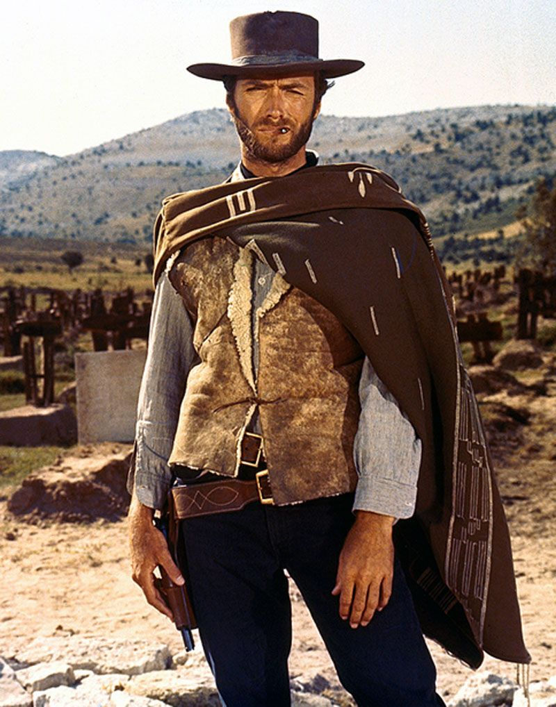 This picture of clint eastwood is a signifier that this film is a western.  From the cowboy hat, pistol hostler to the desert b… | Clint eastwood, Clint,  Movie stars