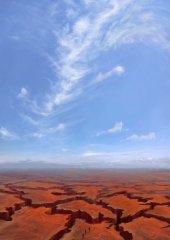 Blue Sky Over the Shattered Plains